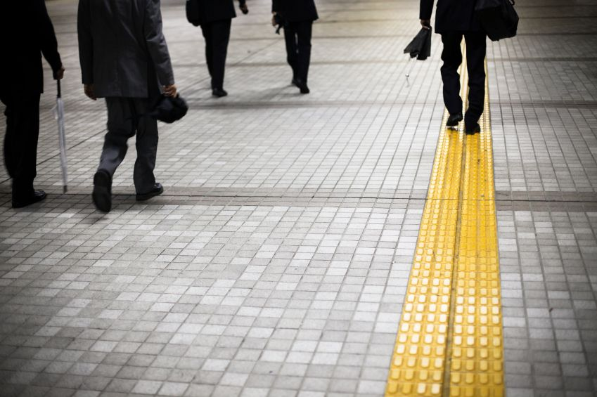 Project Manager walking on double yellow line